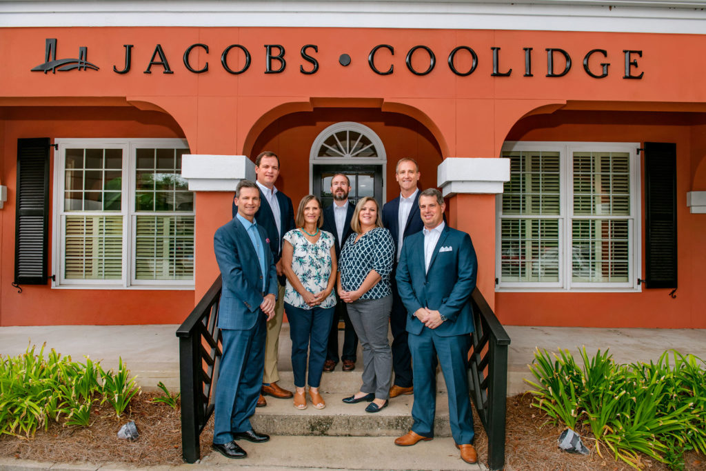 jacob coolidge team in front of building